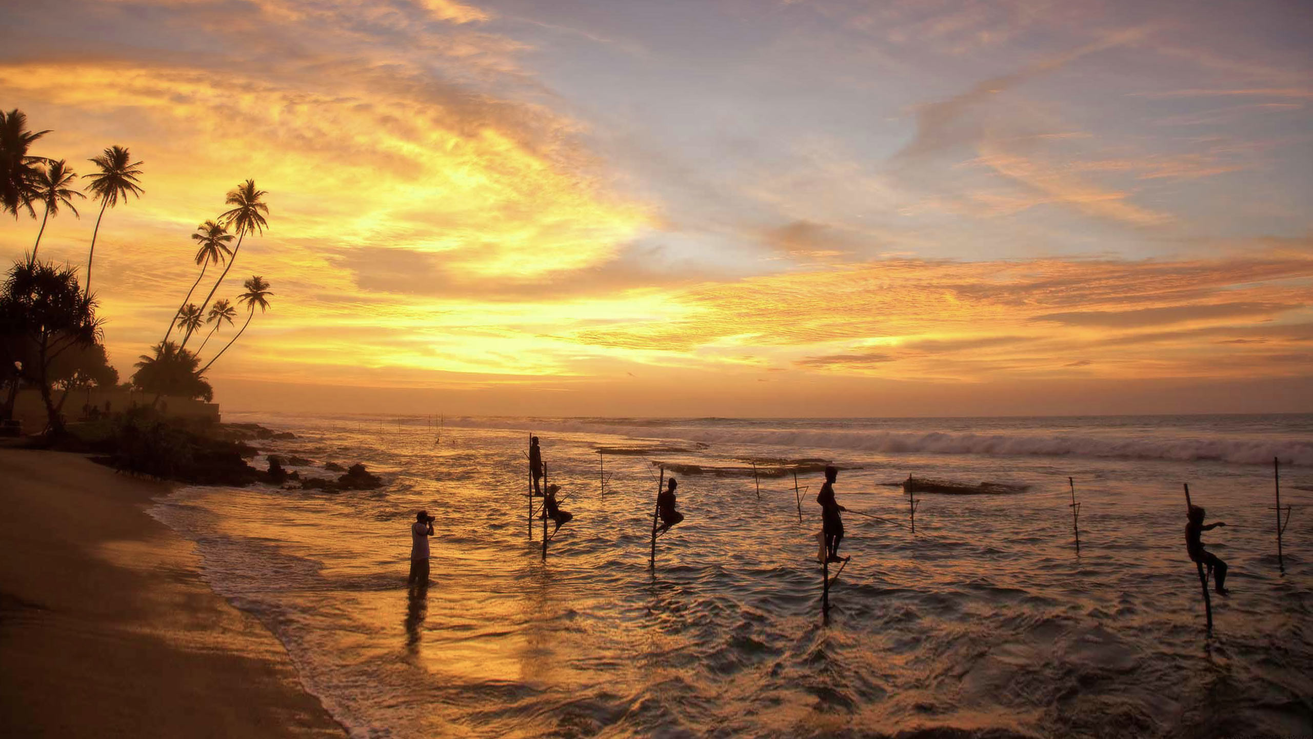 Traditional stilt fishing at sunset in Sri Lanka