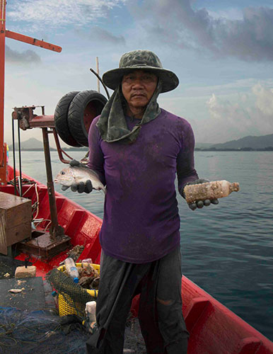 Thai fisherman in Phuket, Thailand.